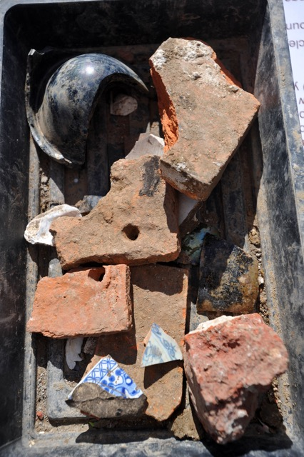 Findings from the one-metre deep trial excavation included glass, bricks and floor tiles